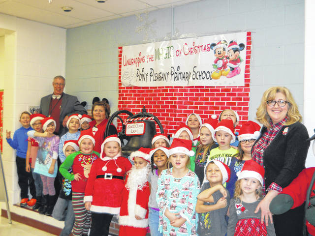 Andrea Justus' first grade class from Point Pleasant Primary School is pictured along with Principal Vickie Workman and School Counselor Kim Browning.