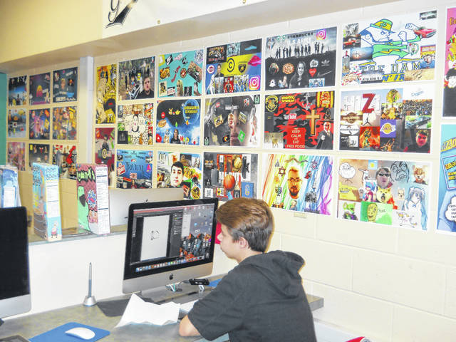 Graphic design student Damon Thompson working on a project at the Mason County Career Center.