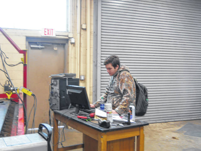 Drafting student Hunter Holcomb working on a project.