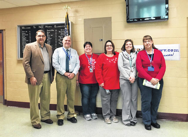 Tom Hunter, Meigs County Community Fund committee member, joins Walter Raynes, New Haven Elementary School principal, and 2017 grant recipients Kira Northup, Kimberly Bond, Lorie Spaun, and Angelia Gilkey to celebrate grants from the New Haven School Fund.