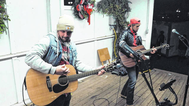 """Devin Henry (left) and Jacob Lones performed """"Fallin' this Christmas"""" at the Gallipolis in Lights opening night event, which was featured in Henry's recently released music video shot by Matt Brinker."""