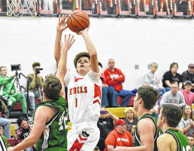 South Gallia's Braxton Hardy (1) releases a shot attempt over a Waterford defender during the first half of Tuesday night's TVC Hocking boys basketball contest in Mercerville, Ohio.