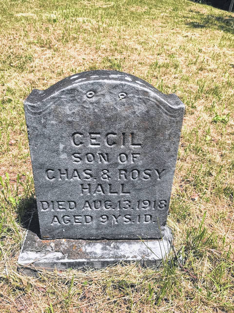 Headstone of Cecil Hall (1909-1918), a 9-year old boy who was struck by a train. He's buried next to multiple family members in Brown Cemetery.