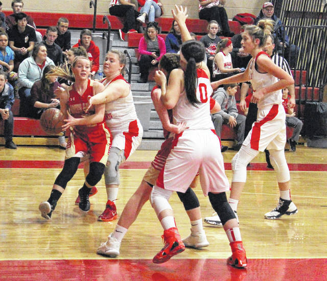 South Gallia senior Olivia Hornsby, left, is closely guarded by Wahama junior Maddy VanMatre during the first half of Thursday night's TVC Hocking girls basketball contest at Gary Clark Court in Mason, W.Va.
