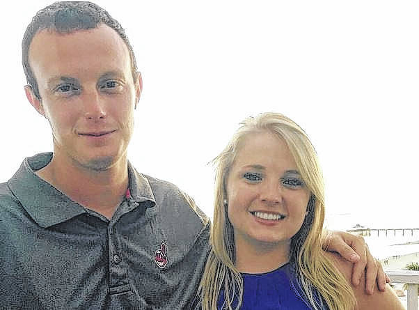 Chris Holter, at left, is pictured with fiancée Carly Good. Holter was injured in a farm equipment accident New Year's Day.
