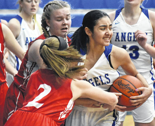 Gallia Academy junior Arianna Jordan is shown as she battles for a rebound against during the first half of the Blue Angels' 56-52 win over Rock Hill on Thursday in Centenary, Ohio.