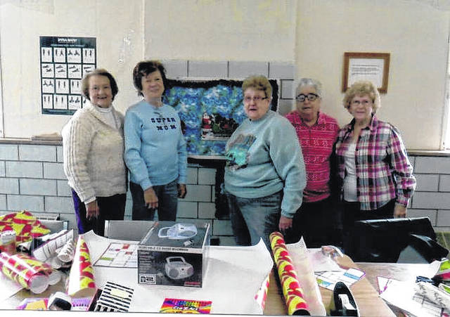 Pictured from left, Molly Miller, Phyllis Hesson, Darlene Haer, Jeanette McDaniel, Isabelle Yoder, from Camp Conley CEOS wrapping Christmas presents for residents at the Lakin Nursing Home.