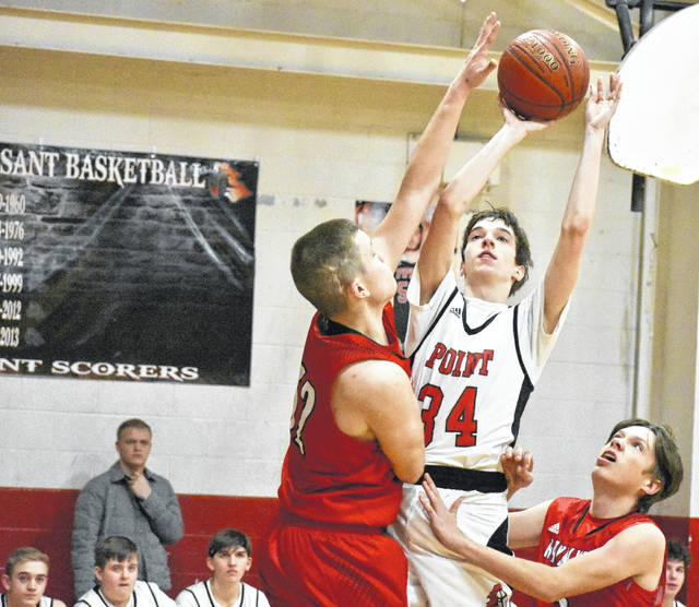 Point Pleasant junior Evan Cobb (34) attempts a shot over a leaping Ravenswood defender during the second half of the Big Blacks' 80-44 loss on Friday at Point Pleasant High School.