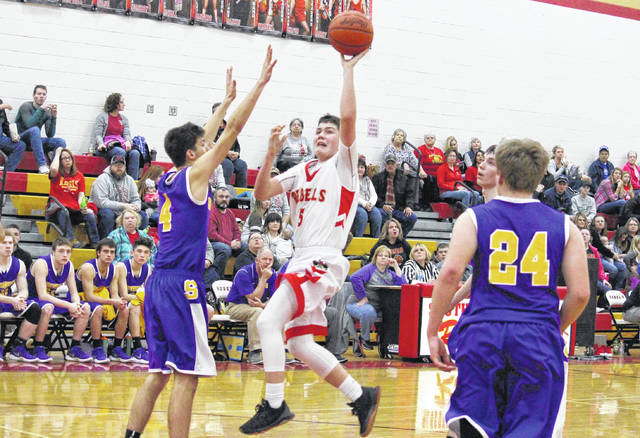 South Gallia senior Curtis Haner (5) hits a two-pointer to end the first half of the Rebels' 62-61 victory over Southern on Friday night in Mercerville, Ohio.