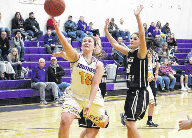 Southern senior Josie Cundiff (13) attempts a two-pointer in front of RVHS senior Jaden Neal (right), during the Lady Tornadoes' 55-40 victory on Saturday in Racine, Ohio.