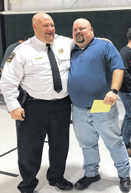 Point Pleasant Fire Chief Jeremy Bryant, at right, is pictured with Jason Baltic, the chief investigator with the West Virginia State Fire Marshal's Office. Baltic was one of many who turned out to surprise Bryant this week ahead of his last day as chief, effective Jan. 31.