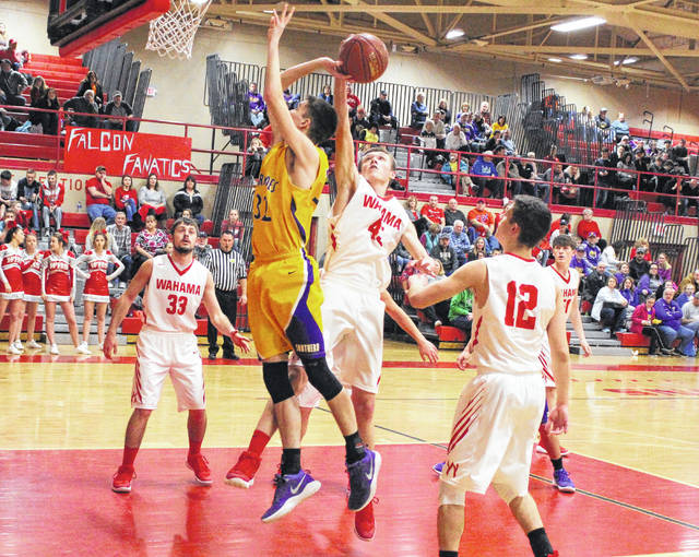 Wahama junior Dakota Belcher (45) blocks a shot attempt by Southern's Brayden Cunningham during the first half of Wednesday night's TVC Hocking boys basketball contest at Gary Clark Court in Mason, W.Va.
