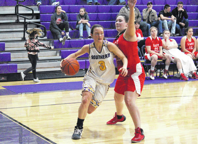 Southern sophomore Baylee Wolfe (3) drives baseline past Wahama freshman Victoria VanMatre, during the first half of the Lady Tornadoes 52-35 victory on Saturday in Racine, Ohio.