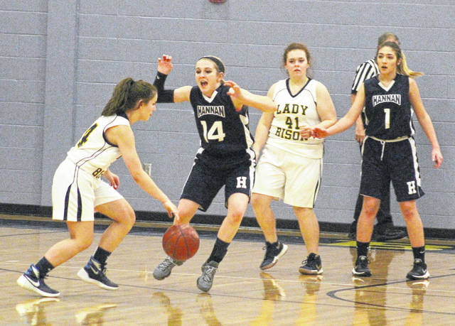 Hannan senior Lindsey Holley (14) applies defensive pressure to a Buffalo player during the second half of Wednesday night's girls basketball contest in Buffalo, W.Va.