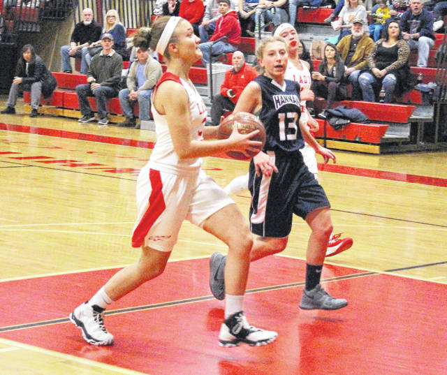 Wahama sophomore Gracie VanMeter drives to the basket for a layup during a Dec. 29, 2017, girls basketball contest against Hannan at Gary Clark Court in Mason, W.Va.