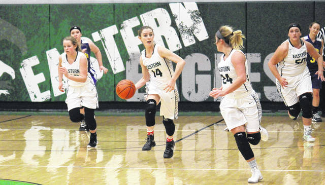 Eastern senior Kaitlyn Hawk (14) passes to junior Alyson Bailey (24) to start the fast break, in the first half of the Lady Eagles' 49-21 victory on Thursday in Tuppers Plains, Ohio.