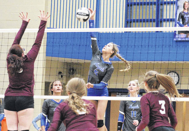 Gallia Academy sophomore Alex Barnes (5) attempts a spike in front of teammates Peri Martin (second from left), and Ashton Webb (11), during the Blue Angels' victory over Vinton County on Oct. 18, 2017 in Centenary, Ohio.