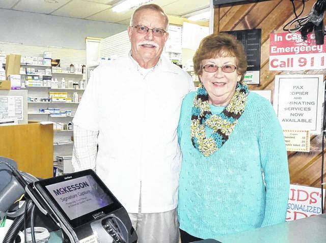 Dan and Cathy Riggs are pictured as they stand behind the counter of Health Aid Pharmacy in New Haven, a business they have owned for the past 34 years. Dan officially retired in the last two weeks, and sold the business last Tuesday to Ed Zatta. Zatta is the owner of Swisher and Lohse Pharmacy in Pomeroy, Ohio, as well as other independent pharmacies in Athens, Ohio, and Ripley, W.Va.