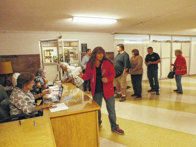 The candidate filing period for the May Primary ends this Saturday. Pictured are early voters preparing to vote outside Mason County Clerk Diana Cromley's office in a previous general election.