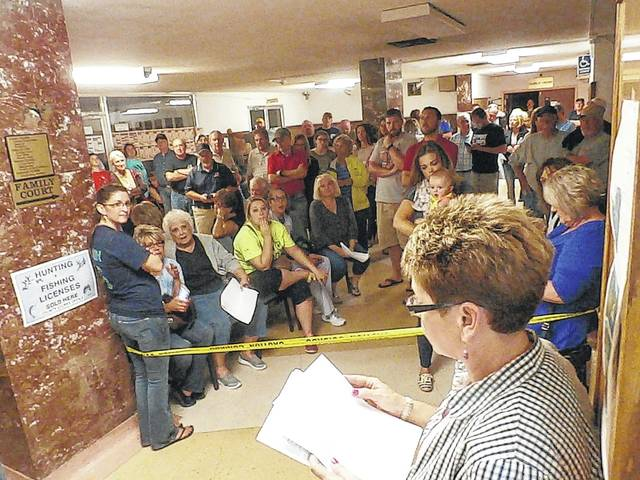 County Clerk Diana Cromley reads election results to a packed Mason County Courthouse during a more recent primary election. This year's primary is on May 8 with the filing deadline for candidates being this past Saturday.
