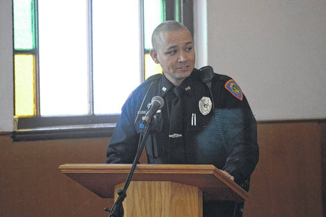 Gallipolis Police Officer Mark Still addresses the Southeastern Ohio NAACP tribute to Martin Luther King, Jr., Monday.