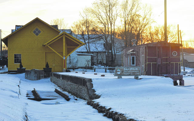 The Gallipolis Railroad Freight Station Museum sits quietly under snow as the sun sets on Gallipolis Friday. Despite the winter's break in construction, museum board members have been working throughout the season to add new board members and organize plans for the return of the spring construction season. For more on the museum, see the story on page six.