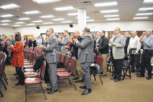 Members of the audience during the 81st annual Gallia Chamber of Commerce Awards Ceremony held a standing ovation in honor of Chester Mike Polcyn who was posthumously awarded the Bud and Donna McGhee Award.