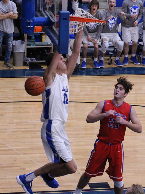 Gallia Academy sophomore Zach Loveday slams home two points during the second half of Saturday night's OVC boys basketball contest against Portsmouth in Centenary, Ohio.