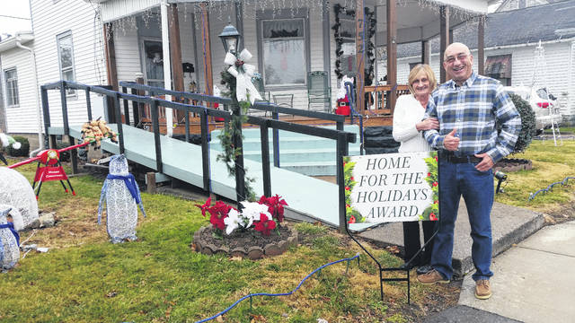 Jim and Janice Warner at their festively decorated home on 752 South Second Avenue in Middleport.
