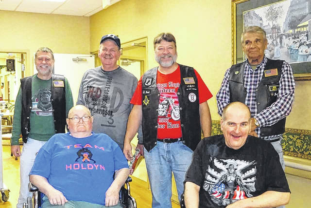 Pictured front row, from left: Mac McCarty, and Michael Brooks. Back row, from left: Kim Hope, David McBeath, Craig Collins, and John Kersey.