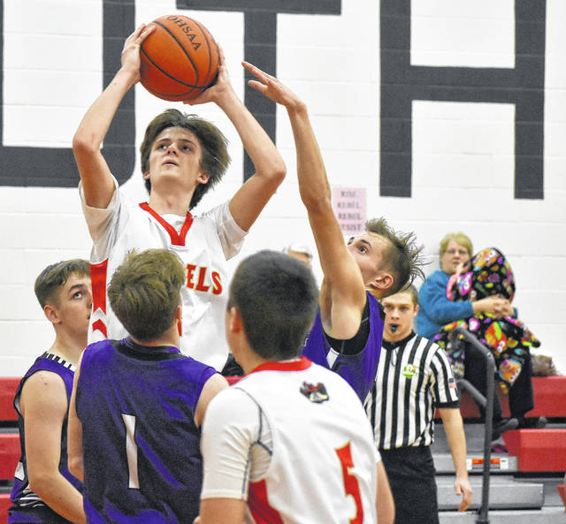 South Gallia's Braxton Hardy (1) attempts a shot against a group of Miller defenders during the second half of the Rebels' 69-51 loss on Wednesday night in Mercerville, Ohio.