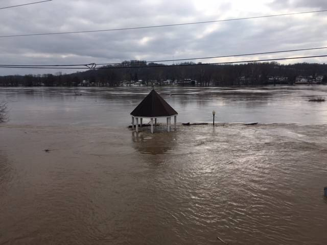 Scenes from Pomeroy on Sunday show the water has inundated the parking lot and made its way on to Main Street.