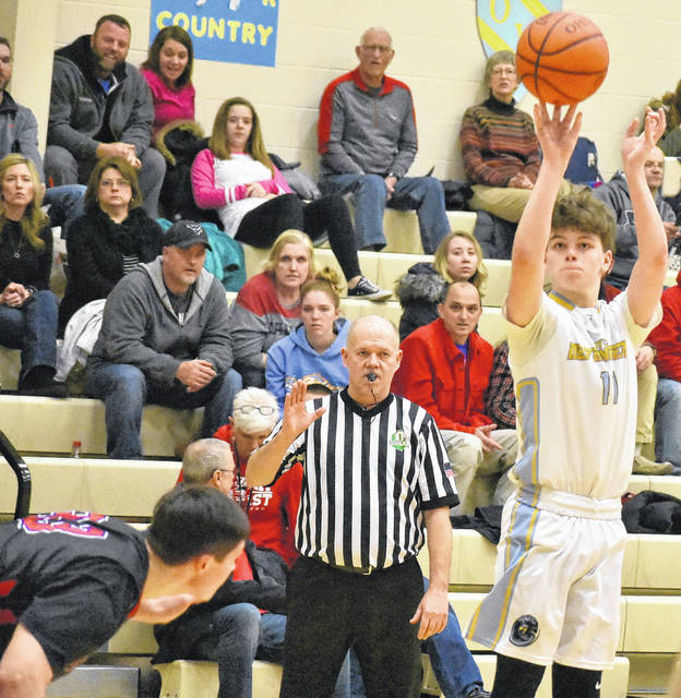 Ohio Valley Christian freshman Bryce Gruber (11) attempts a shot against a Calvary Baptist Academy defender the first half of the Defenders 86-43 loss on Friday night in Gallipolis, Ohio.