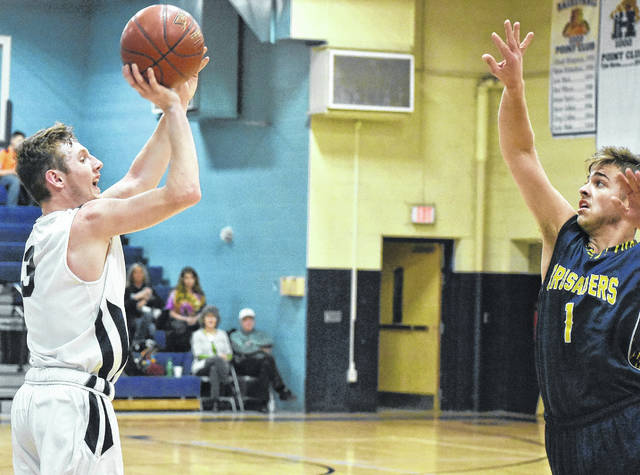 Hannan senior Malachi Cade (3) attempts a shot against a Jammie Darrin Christian Academy defender during the first half of Thursday night's 92-61 victory in Ashton, W.Va.