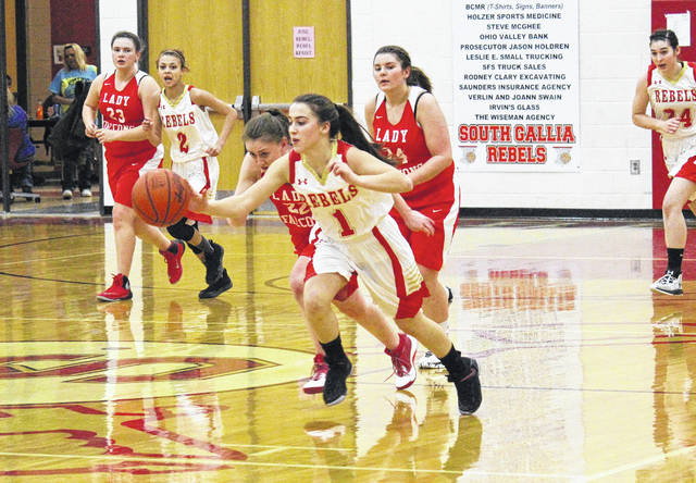 South Gallia sophomore Alyssa Cremeens (1) comes up with a steal and leads the fast break, during the Lady Rebels' 59-38 victory on Thursday in Mercerville, Ohio.