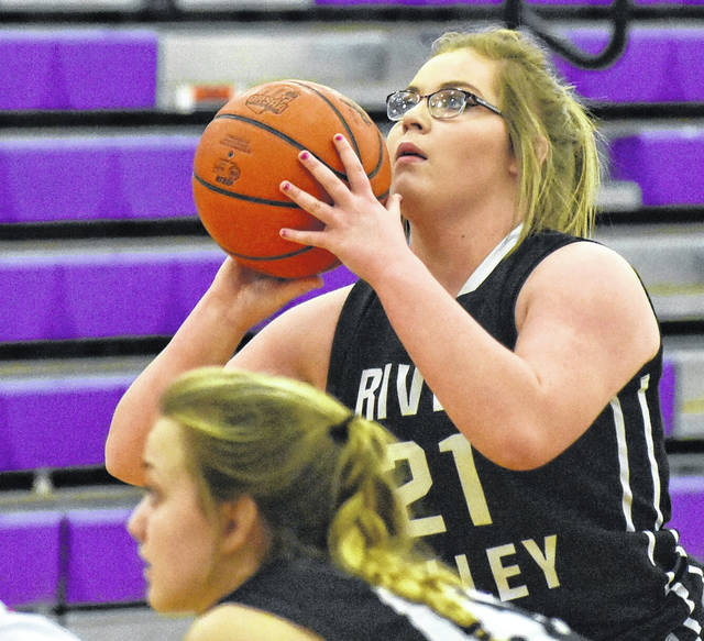 River Valley junior Kelsey Brown (21) attempts a free throw during the first half of Monday night's 41-23 victory over New Lexington in Logan, Ohio.