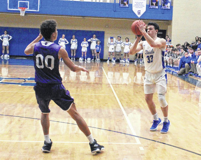 Gallia Academy senior Gage Harrison (33) releases a three-point attempt during the first half of Friday night's OVC boys basketball contest against Chesapeake in Centenary, Ohio.