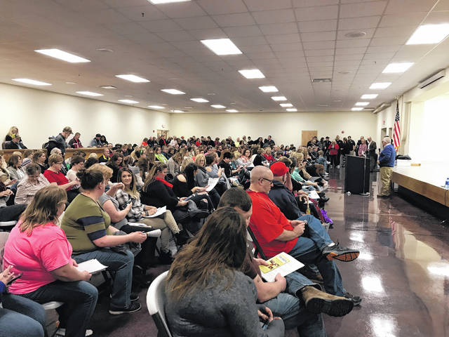 It was standing room only on Thursday evening as teachers and service personnel with Mason County Schools debated on whether or not to walk out on Friday in protest of PEIA insurance issues and pay rates. These walk outs are happening across the state.