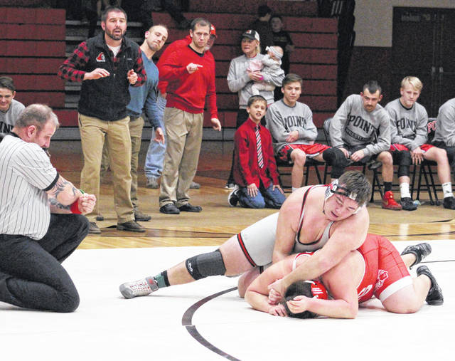Point Pleasant coaches Jed Ott, David Bonecutter and John Bonecutter watch as sophomore Jacob Muncy locks in a hold on a Parkersburg opponent during the heavyweight match on Wednesday night in Point Pleasant, W.Va.