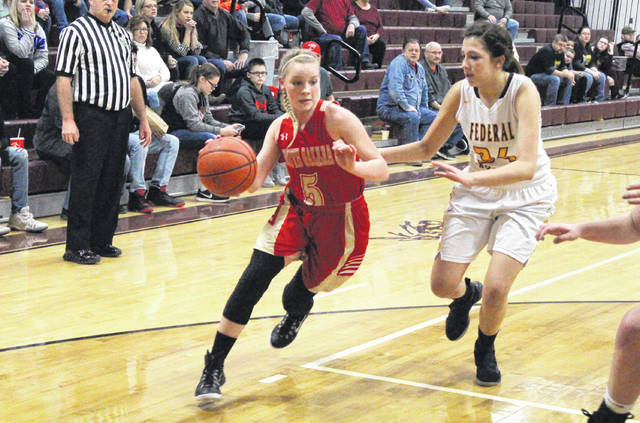 South Gallia senior Olivia Hornsby (5) drives past a Federal Hocking defender, during the Lady Rebels' 40-27 sectional final setback on Saturday in Rocksprings, Ohio.