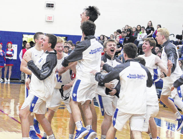 Members of the Gallia Academy basketball team erupt in celebration moments after capturing the program's first sectional title since 2008 following a 42-34 victory over Zane Trace on Friday night at Southeastern High School in Londonderry, Ohio.