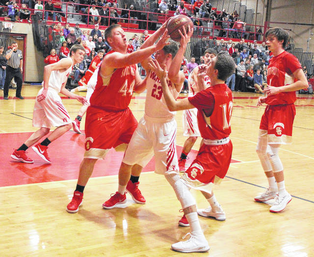 South Gallia defenders Austin Day (44) and Austin Stapleton (12) apply pressure to Wahama's Brady Bumgarner (23) during the first half of Friday night's TVC Hocking boys basketball contest in Mason, W.Va.