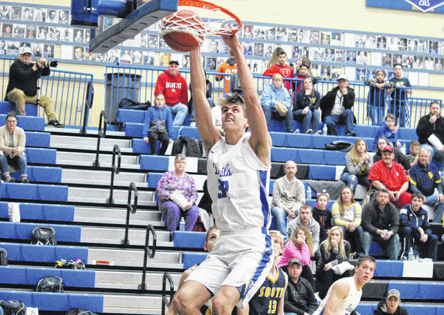 Gallia Academy sophomore Zach Loveday slams home a dunk for two of his game-high 37 points, during the Blue Devils' 68-49 victory on Friday in Centenary, Ohio.