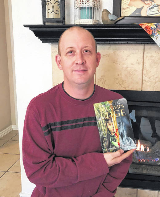 """Brian Hendrickson, a Mason native and U.S. Army Chief Warrant Officer 2, recently had his first book published. The fantasy fiction is titled, """"Vengeance at a Dagger's Edge."""""""
