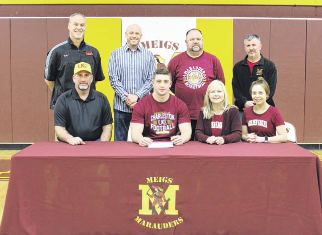 On Wednesday at Meigs High School, senior Lane Cullums signed his letter of intent to join the University of Charleston football team. Sitting in the front row, from left, are Decker Cullums, Lane Cullums, Rhonda Cullums and Ashley Mankin. Standing in the back row are Marauders head coach Mike Bartrum, MHS Principal Travis Abbott, Meigs athletic director Steven Wood and Marauders assistant coach Rick Olexa.