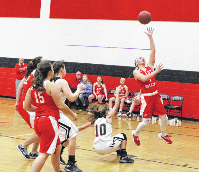 Wahama sophomore Hannah Rose, right, releases a shot attempt over a Point Pleasant defender during the second half of Wednesday night's girls basketball contest in Point Pleasant, W.Va.