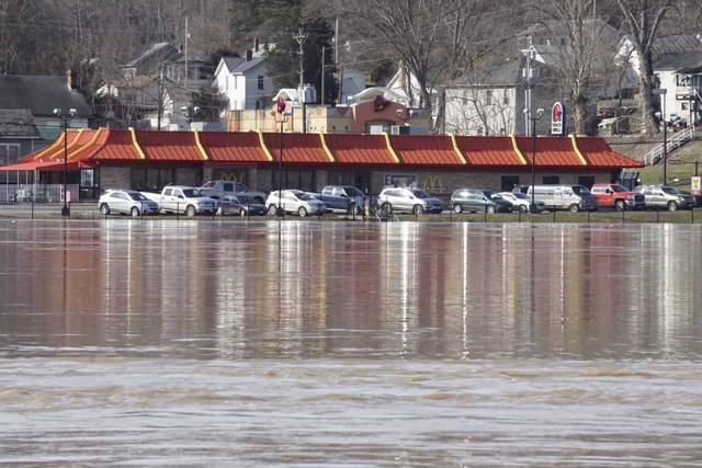 Pictured are photos taken from the Mason side of the Ohio River on Sunday afternoon. Photos include the water level gauge alongside the Bridge of Honor, downtown Pomeroy and the Stewart-Johnson V.F.W./Lottie Jenks Memorial Park.