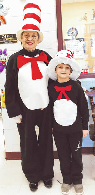 Pictured with the Cat in the Hat is first grade student from Mrs. Andrea Justus' class, Brylon McMillian, who dressed as the Cat in the Hat.