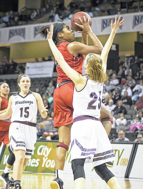 Rio Grande's Alexis Payne puts up a shot over Morningside College's Grace Meyer during Thursday night's NAIA Division II Women's Basketball National Championship Tournament game at the Tyson Events Center in Sioux City, Iowa. Payne scored a team-high 21 points in the RedStorm's 97-69 loss to the Mustangs.