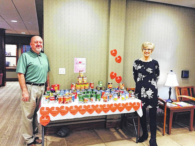 "From bake sales to purchasing Farmers Bank hearts, the ""Spreading the Love"" campaign was a month long effort to raise funds and food for local food pantries and/or shelters. A total of $1,799 was collected, with $764 going to the Mulberry Community Center, $860 to the Bend Area Food Pantry and $175 to the Mason County Homeless Shelter. Pictured are Edna Weber and Des Jeffers of the Pomeroy branch."